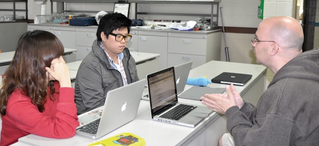 In biology class, ninth grade Jin Kim and Danny Lim learn about chemical reactions for carbon. The two students and Mr. Osborne discussed about how results of a chemical reaction for carbon look alike.