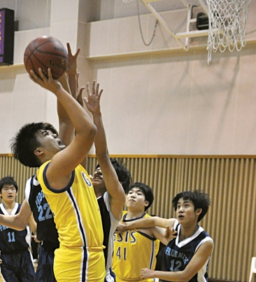 At the start of the second quarter Kelvin Lee drives past the KIS players for a layup and scores two points for the GSIS Knights. In the process of his layup he was fouled which gave him the opportunity for a foul shot.