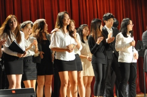 """Students from the DP concert rush up to the stage during the chorus of """"All You Need is Love"""". Students dedicated this song to Dr. Park, as this was the final performance of the night."""