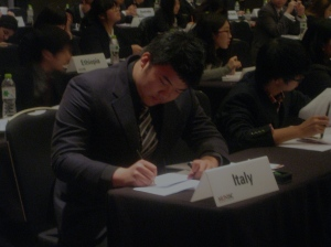 Kelvin Lee makes notes on the resolution he is about to debate.