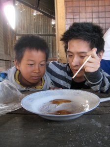 Danny Jung helps a Burmese orphan create his own Koraen-style sugar candy.
