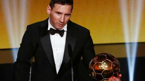 Messi of Argentina holds the World Player of the Year award during the FIFA Ballon d'Or 2015 ceremony in Zurich